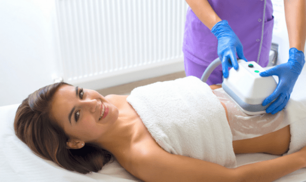 Woman receiving CoolSculpting in Knoxville, TN
